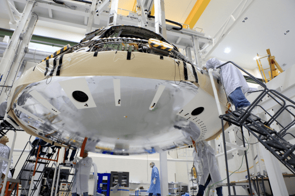 Orion heat shield attached to the bottom of the capsule by e