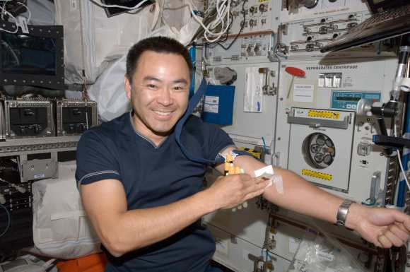 Expedition 32 astronaut Aki Hoshide with a fistfull of blood samples on the International Space Station in 2012. Credit: NASA