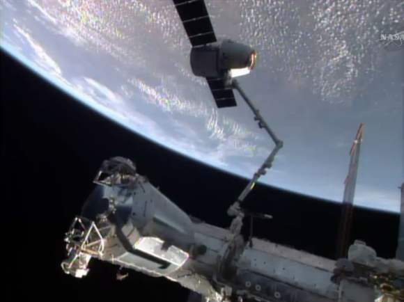 The SpaceX Dragon commercial cargo craft was in the grips of the Canadarm2 before being released for a splashdown in the Pacific Ocean.  Credit: NASA