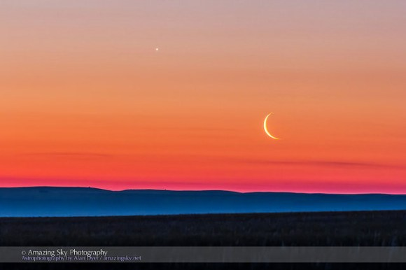 The waning crescent Moon below Venus, rising in the east on June 24, 2014 as seen from home over the flat prairie horizon of southern Alberta, Canada. Credit and copyright: Alan Dyer.