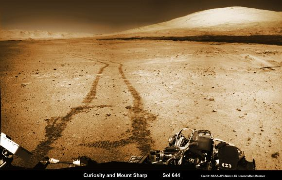 NASA's Curiosity rover trundles towards Mount Sharp (right) across the alien terrain of Mars - our Solar Systems most Earth-like planet - and leaves behind dramatic wheel tracks in her wake, with Gale crater rim visible in the distance at left. Curiosity captured this photo mosaic of her wheel tracks, mountain and crater rim on Sol 644 after departing 'Kimberley' drill site in mid-May 2014. Navcam raw images were stitched and colorized. Credit: NASA/JPL-Caltech/Marco Di Lorenzo/Ken Kremer – kenkremer.com