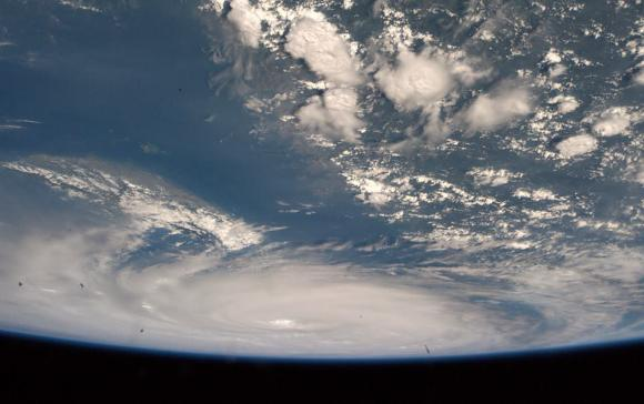 """Supertyphoon Neoguri did not even fit into our fisheye lens view. I have never seen anything like this."" Taken from the ISS on 8 July 2014. Credit: ESA/NASA/Alexander Gerst"