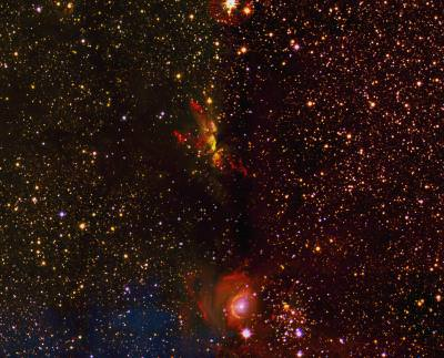 Caption: The area shown here was part of the very first image taken for the UWISH2 survey. It shows on the top a region of massive star formation (called G35.2N) with two spectacular jets. On the bottom an intermediate mass young stellar cluster (Mercer14) can be seen. Several jets are visible in its vicinity, as well as a region of photo-ionized material surrounding a young massive star. Credit: University of Kent