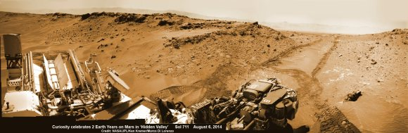 2 Earth Years on Mars!  NASA's Curiosity rover celebrated the 2nd anniversary on Mars at 'Hidden Valley' as shown in this photo mosaic view captured on Aug. 6, 2014, Sol 711.  Note the valley walls, rover tracks and distant crater rim. Navcam camera raw images stitched and colorized.  Credit: NASA/JPL-Caltech/Ken Kremer-kenkremer.com/Marco Di Lorenzo