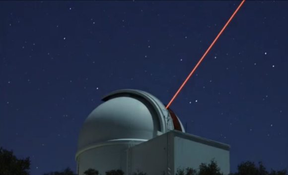 Still from a timelapse video showing the Robo-AO laser originating from t