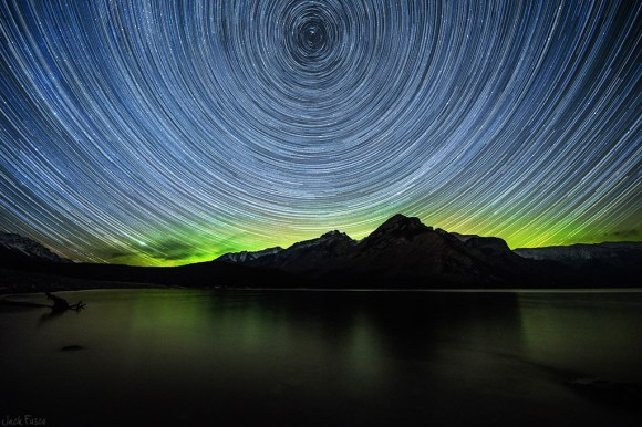 Star trails over Lake Minnewanka in Alberta, Canada. Credit and copyright: Jack-Fusco.