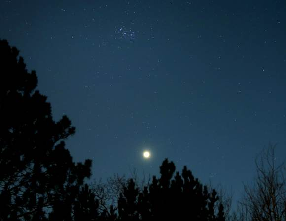 Venus glides up to the Pleiades or Seven Sisters star cluster this week. This was the view at dusk on April 4. Credit: Bob King