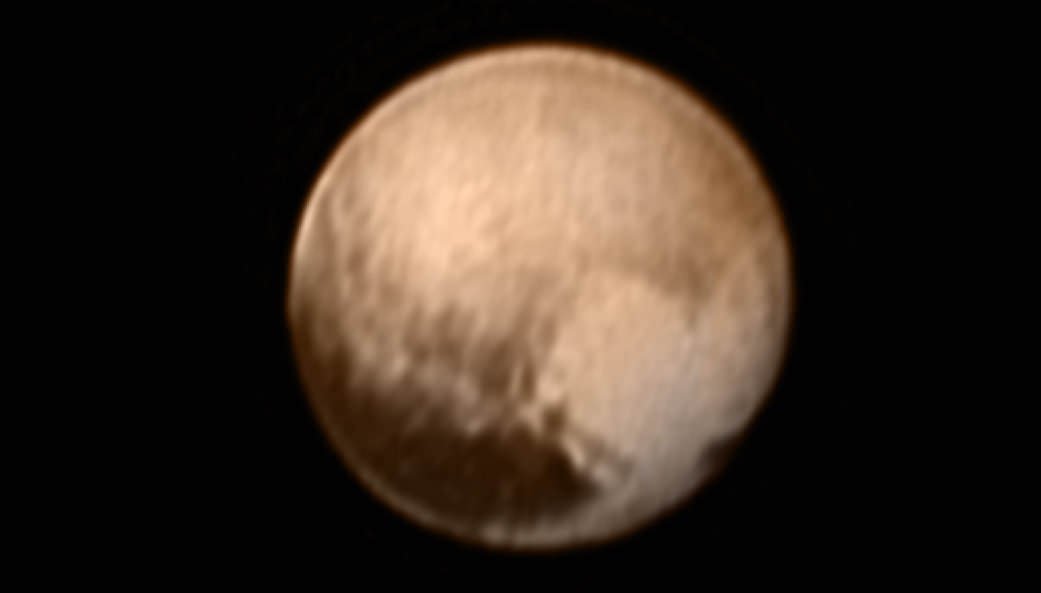 "Pluto's ""Heart"" is seen in this new image of Pluto from New Horizons' Long Range Reconnaissance Imager (LORRI) received on July 8, 2015 after normal science operations resumed following the scary July 4 safe mode anomaly that briefing shut down all science operations.   The LORRI image has been combined with lower-resolution color information from the Ralph instrument.   Credits: NASA-JHUAPL-SWRI"