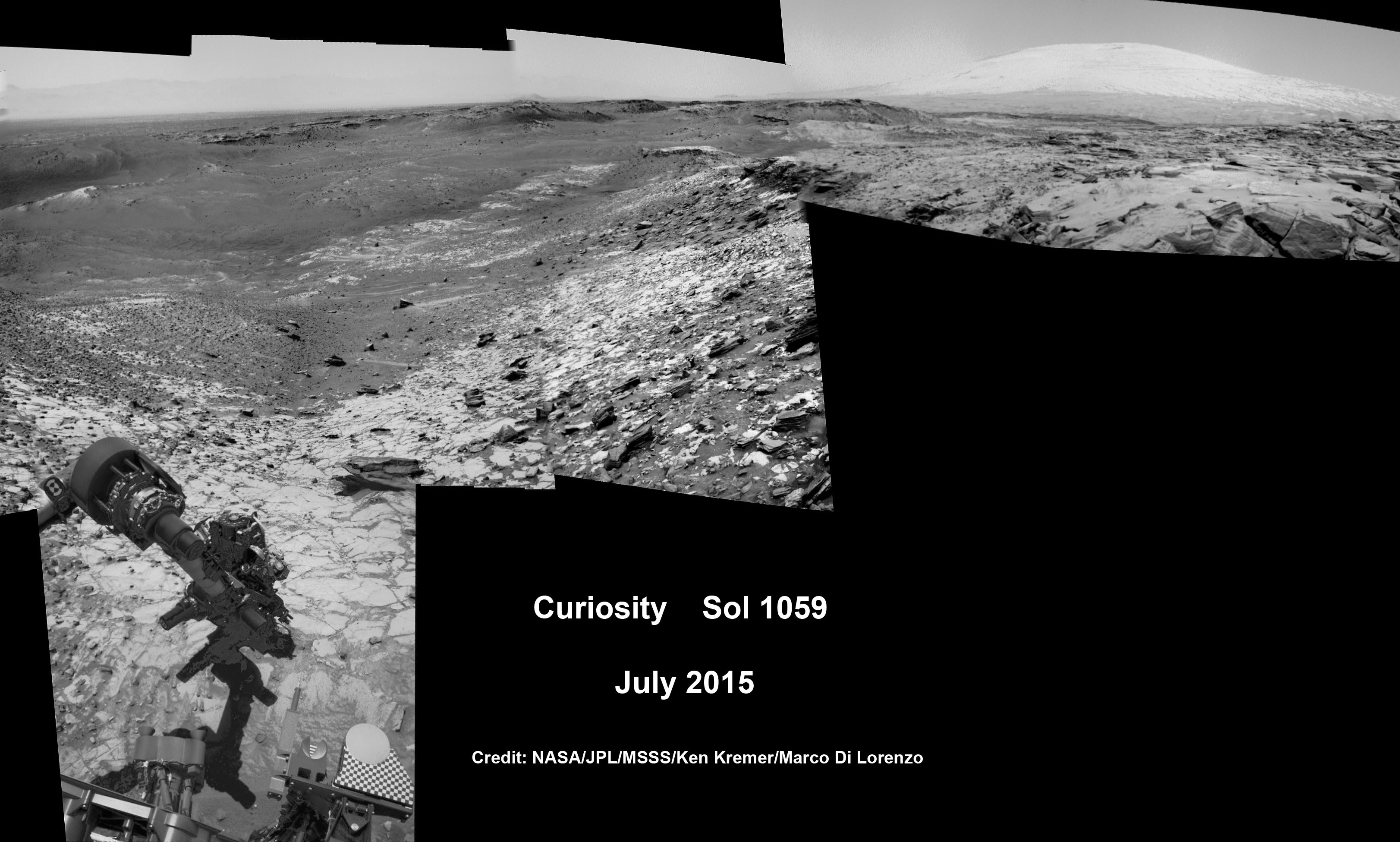 "Curiosity conducts test drill at ""Buckskin"" rock target at bright toned ""Lion"" outcrop on the lower region of Mount Sharp on Mars, seen at right.   Gale crater rim seen in the distant background at left, in this composite mosaic of navcam raw images taken to Sol 1059, July 30, 2015.  Navcam camera raw images stitched. Credit:  NASA/JPL-Caltech/Ken Kremer/kenkremer.com/Marco Di Lorenzo"