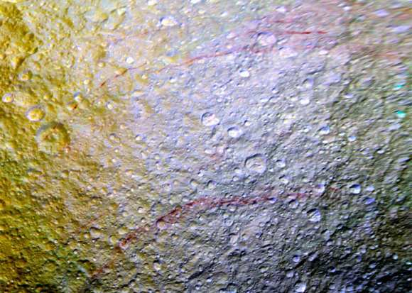 Enhanced-color image from Cassini showing red streaks on Tethys (NASA/JPL-Caltech/Space Science Institute)