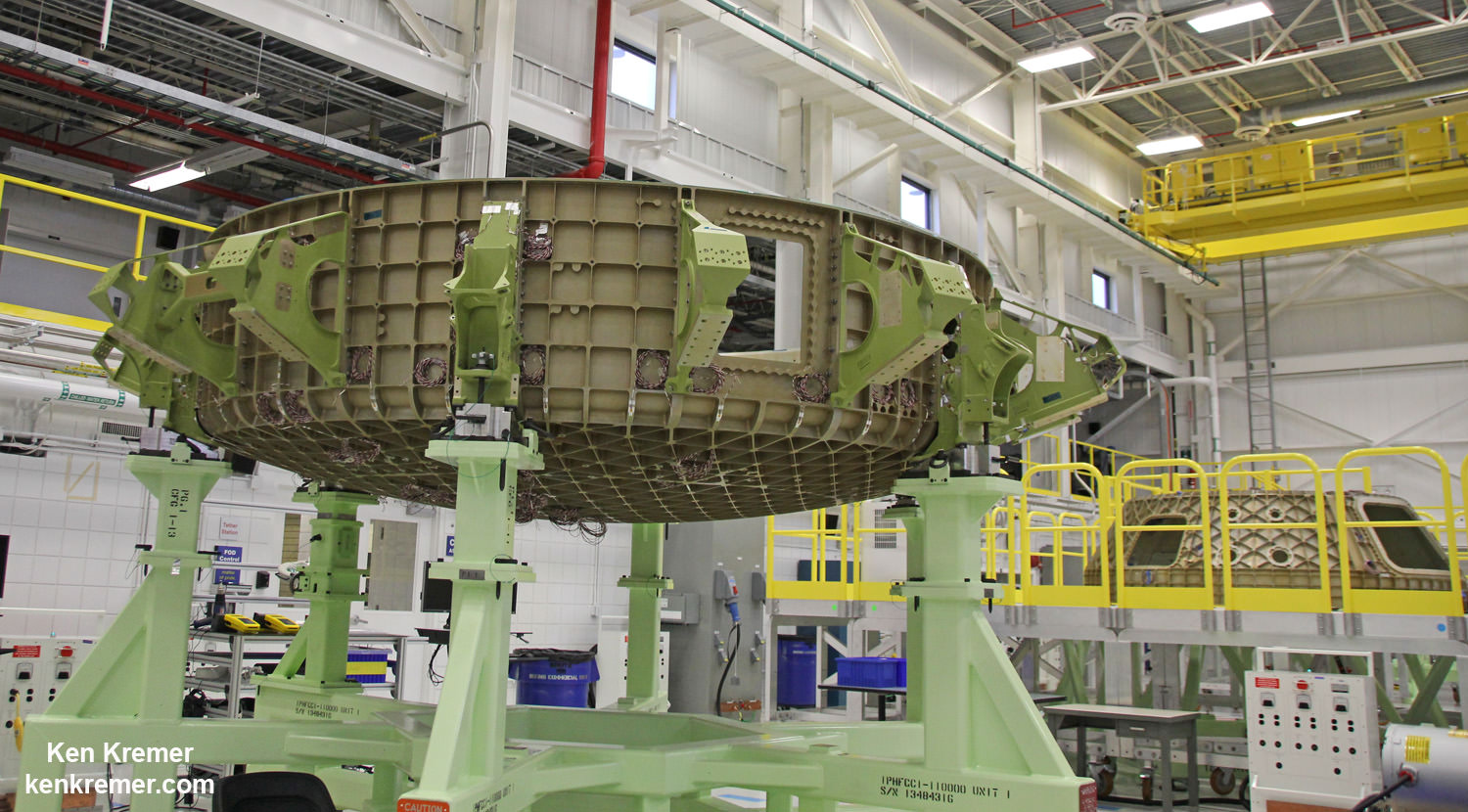 First view of the Boeing CST-100 '?Starliner?' crewed space taxi at the Sept. 4, 2015 Grand Opening ceremony held in the totally refurbished C3PF manufacturing facility at NASA's Kennedy Space Center. These are the upper and lower segments of the first Starliner crew module known as the Structural Test Article (STA) being built at Boeing's Commercial Crew and Cargo Processing Facility (C3PF) at KSC. Credit: Ken Kremer /kenkremer.com