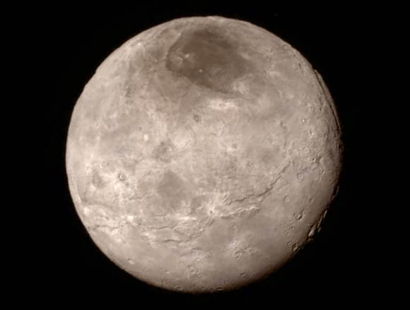 Details of Pluto's largest moon, Charon, are revealed in this image from New Horizons' Long Range Reconnaissance Imager (LORRI), taken July 13, 2015, from a distance of 289,000 miles (466,000 kilometers), combined with color information obtained by New Horizons' Ralph instrument on the same day. The distinctive red  marking in Charon's north polar region is currently being studied by scientists. Credit: NASA/Johns Hopkins University Applied Physics Laboratory/Southwest Research Institute)
