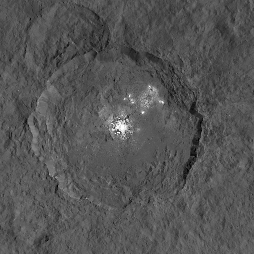This image, made using images taken by NASA's Dawn spacecraft during the mission's High Altitude Mapping Orbit (HAMO) phase, shows Occator crater on Ceres, home to a collection of intriguing bright spots.  Credits: Image credit: NASA/JPL-Caltech/UCLA/MPS/DLR/IDA