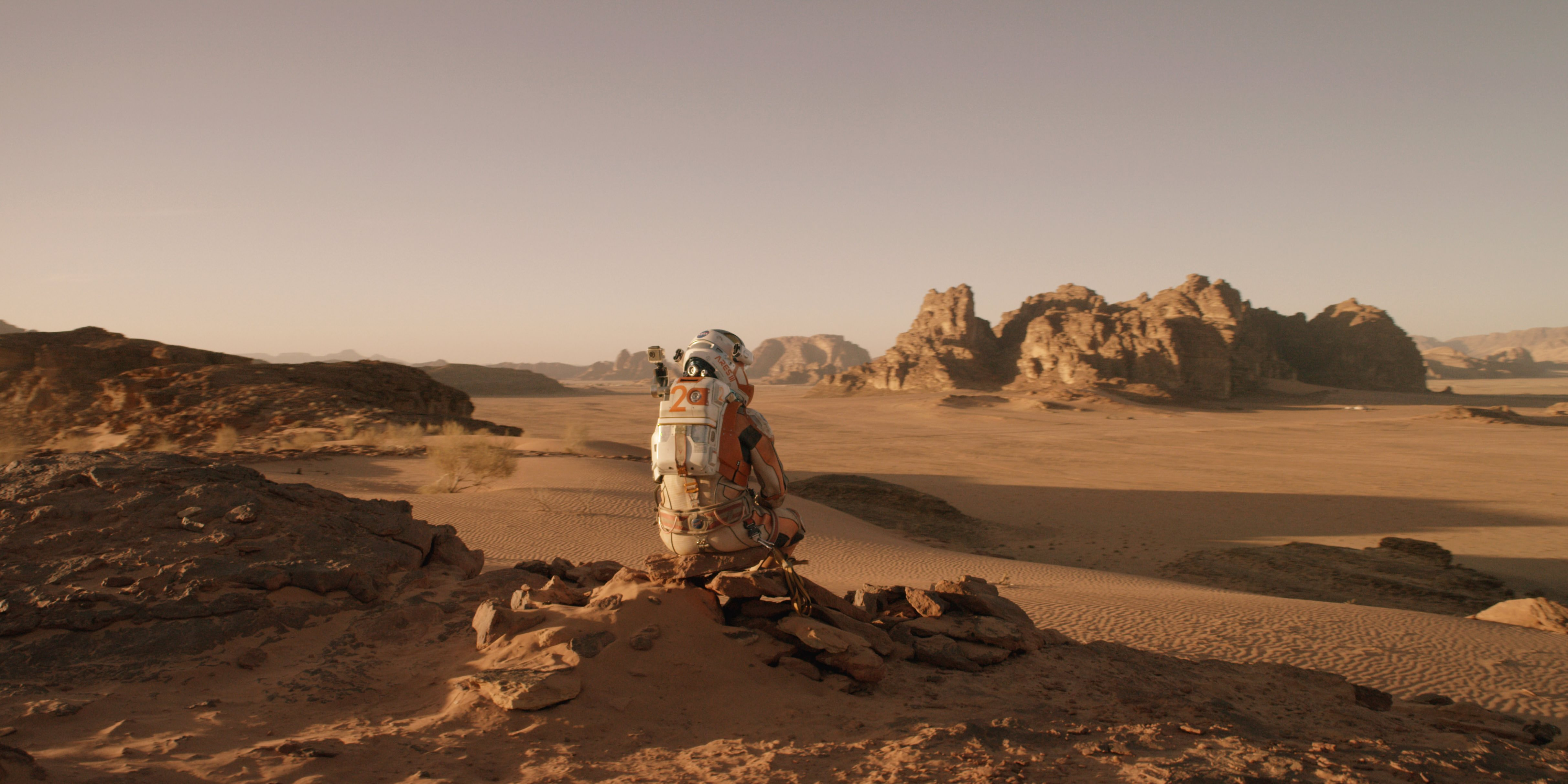 Scene from 'The Martian' starring Matt Damon as NASA astronaut Mark Watney contemplating magnificent panoramic visit while stranded on Mars.  Credits: 20th Century Fox