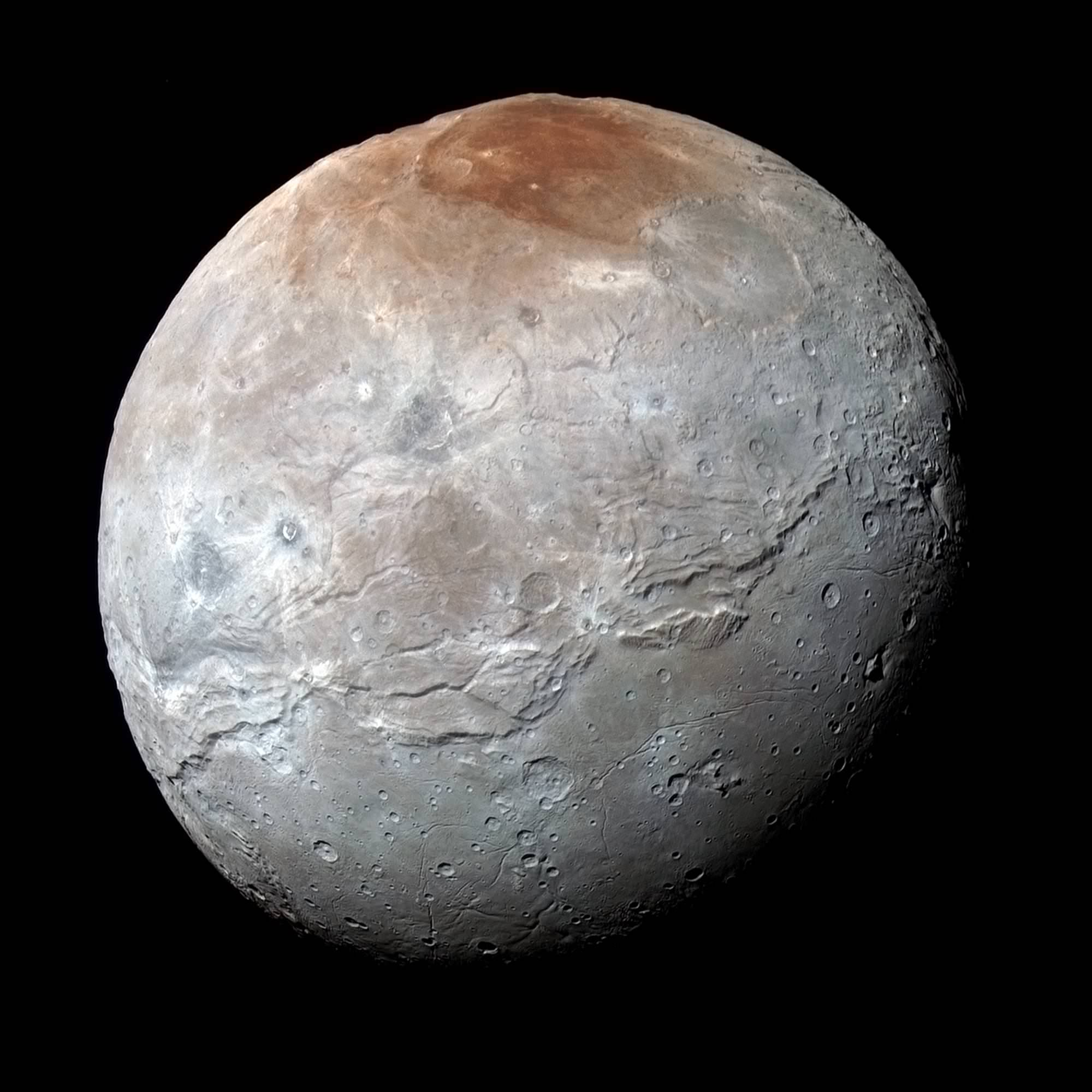 Charon in Enhanced Color. NASA's New Horizons captured this high-resolution enhanced color view of Charon just before closest approach on July 14, 2015. The image combines blue, red and infrared images taken by the spacecraft's Ralph/Multispectral Visual Imaging Camera (MVIC); the colors are processed to best highlight the variation of surface properties across Charon. Charon's color palette is not as diverse as Pluto's; most striking is the reddish north (top) polar region, informally named Mordor Macula. Charon is 754 miles (1,214 kilometers) across; this image resolves details as small as 1.8 miles (2.9 kilometers).  Credits: NASA/JHUAPL/SwRI
