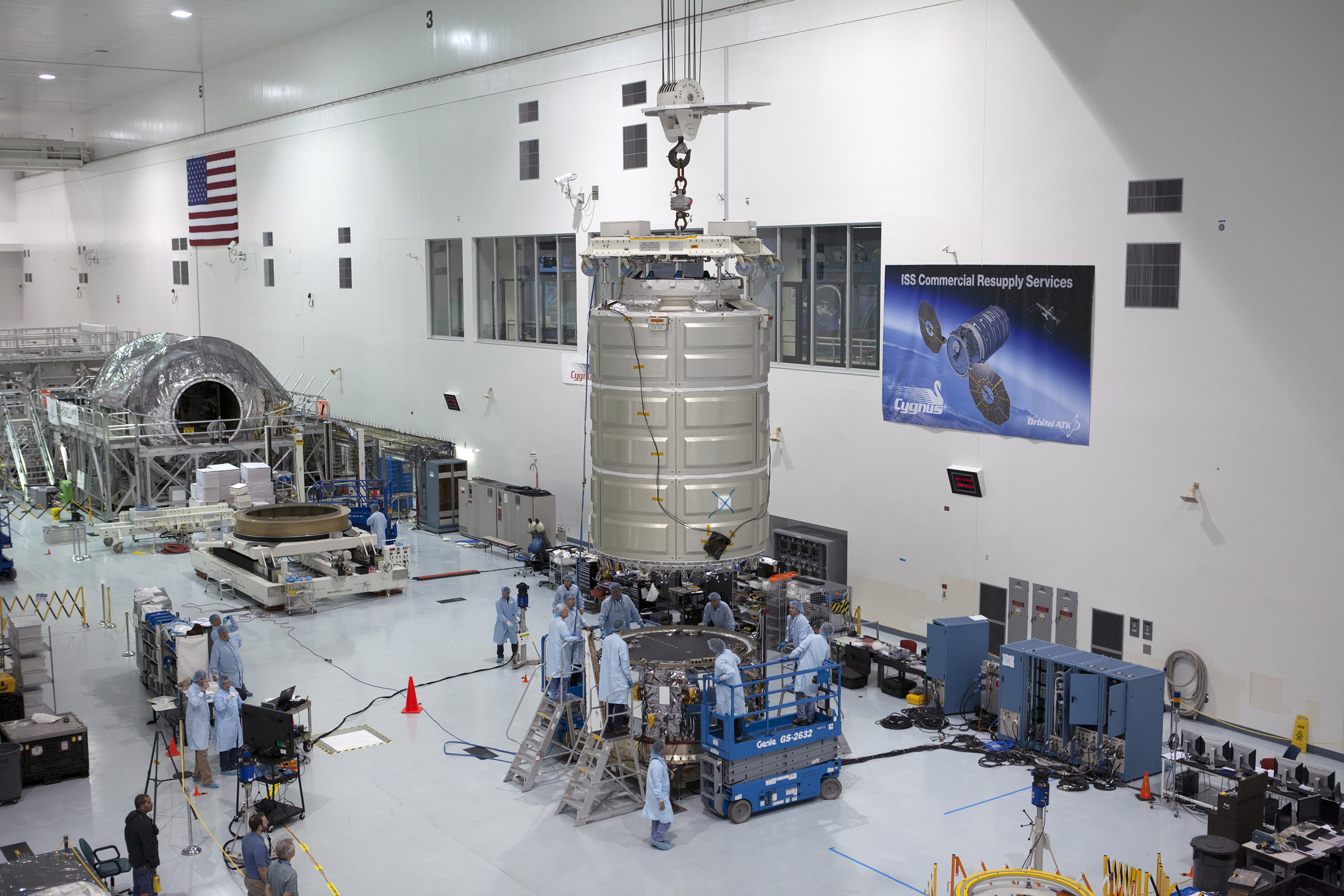 Orbital ATK Cygnus cargo spacecraft being processed at the Kennedy Space Center for upcoming unmanned cargo launch to the International Space Station (ISS) on Dec. 3, 2015.   Cygnus will ferry more than 7,000 pounds of supplies, equipment and experiments to the ISS.  Orbital ATK is vying for NASA's new Commercial Resupply Services (CRS) contract to supply the ISS through 2024.  Credit: NASA