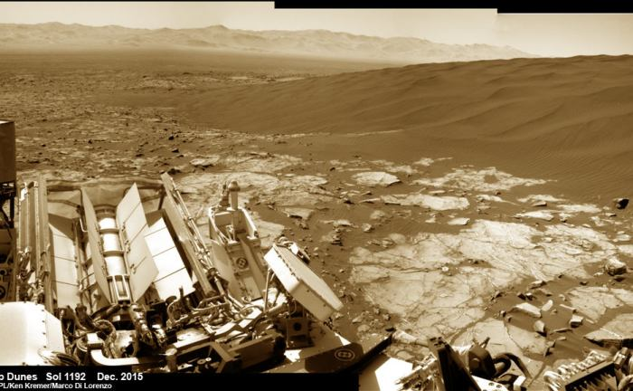 Curiosity explores Namib Dunes at base of Mount Sharp, for first in-place study of an active sand dune anywhere other than Earth.  See Gale Crater rim in the distance.This colorized photo mosaic is stitched from navcam camera raw images taken on Sol 1192, Dec. 13, 2015.  Credit: NASA/JPL/Ken Kremer/kenkremer.com/Marco Di Lorenzo