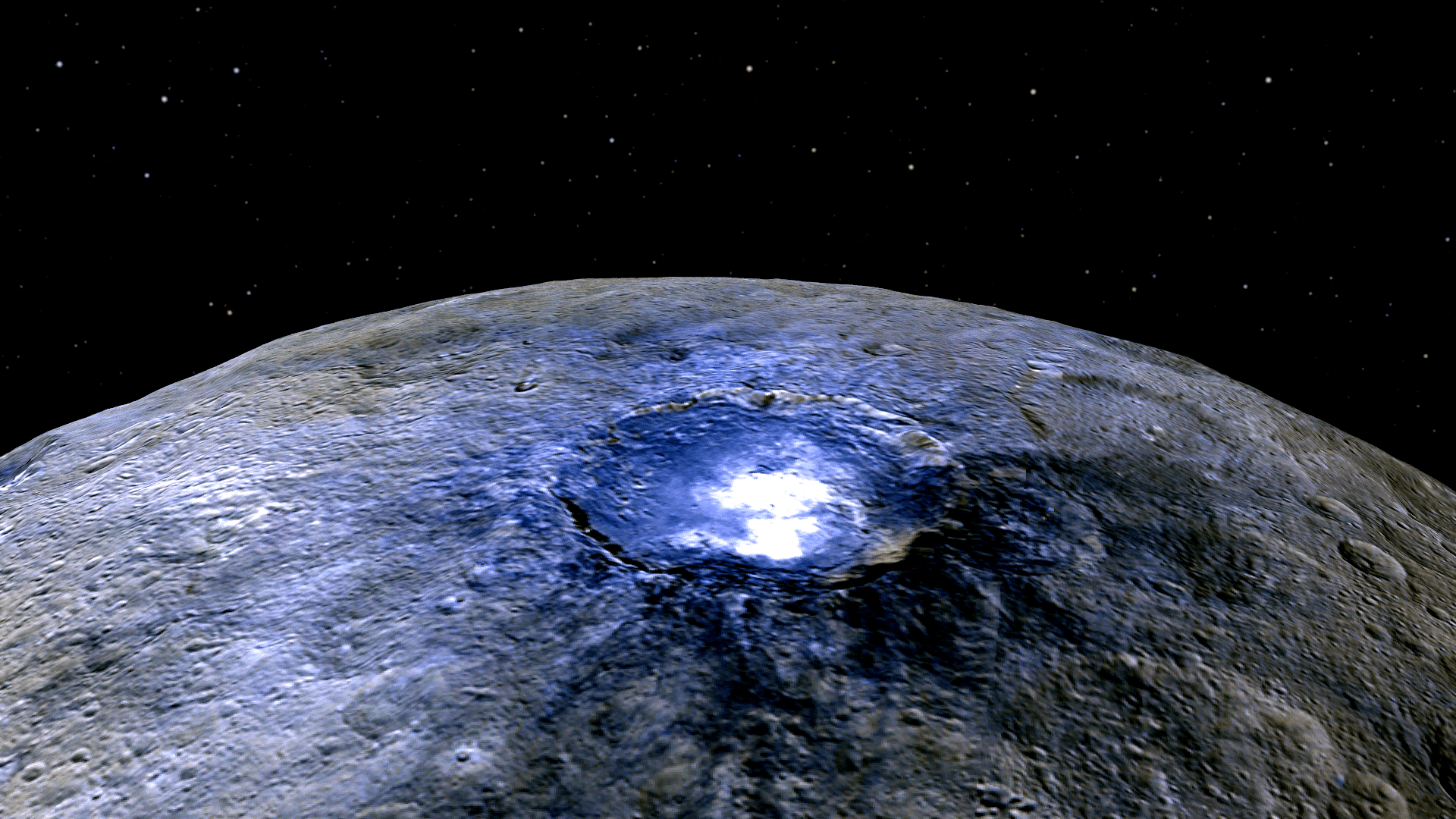 This representation of Ceres' Occator Crater in false colors shows differences in the surface composition.  Occator measures about 60 miles (90 kilometers) wide.  Credits: NASA/JPL-Caltech/UCLA/MPS/DLR/IDA