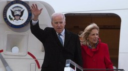 U.S. Vice President Joe Biden, left, accompanied by his wife Jill Biden, right, walks out of Air Force Two upon arrival at the Tegel airport in Berlin, Germany, Friday, Feb. 1, 2013.