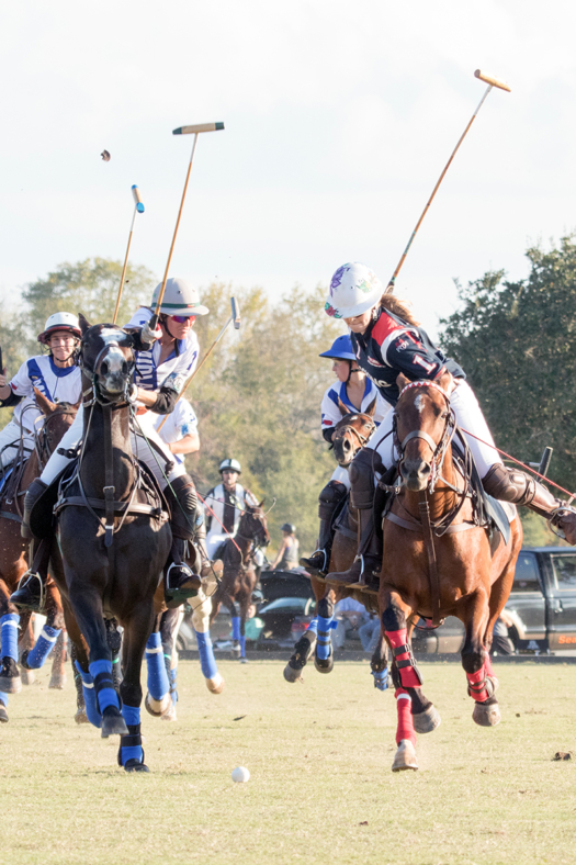 Rocking P's Courtney Price at full speed as Midland Polo Club's Molly Smith prepares for the hook.