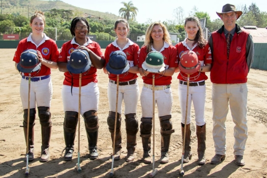 Shariah Harris with the Cornell University polo team.