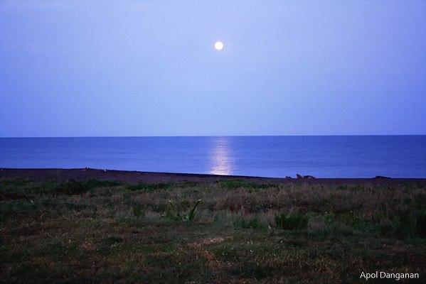 Full moon setting at Palaui Island