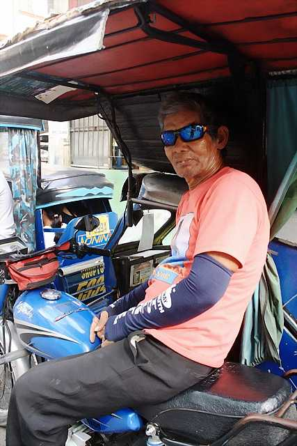 Mang Eduard wearing his sun protector on his arm