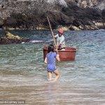 Mexican fisherman using tub as boat