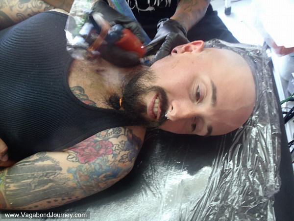 Wade having his neck tattooed