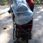 Fully loaded cart with travel gear