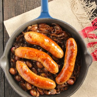 Sausages with caramelized onions and grapes