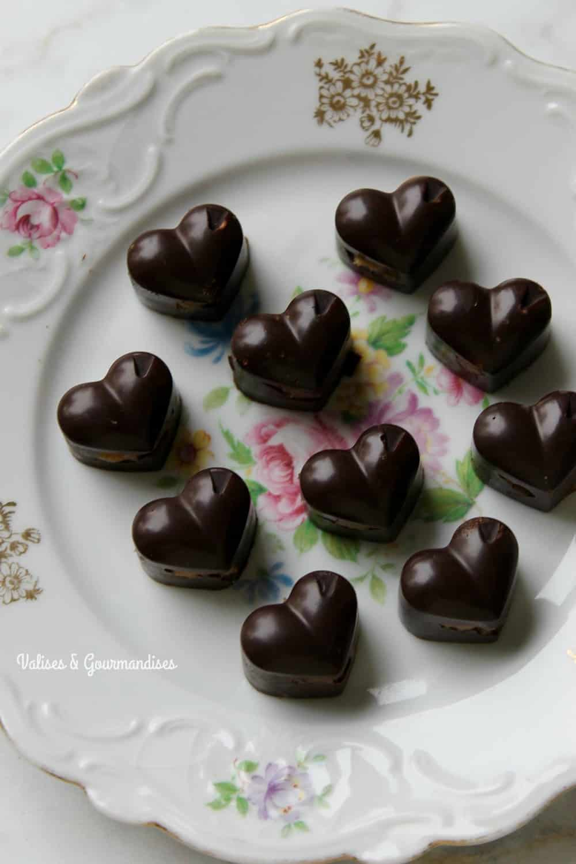 Vegan chocolate pralines with salted tahini date caramel