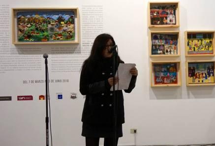 La poeta Vanessa Martínez leyendo en el LUM. Lima, 2018