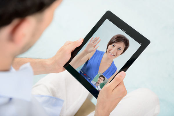 A young couple talking to each other via online video chat.