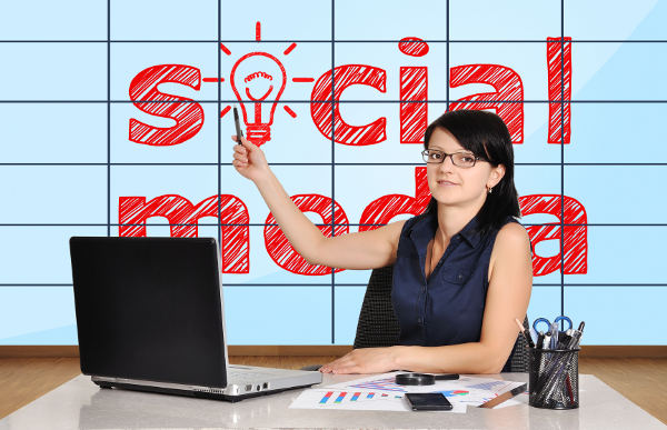 woman in office pointing at plasma panel with social media