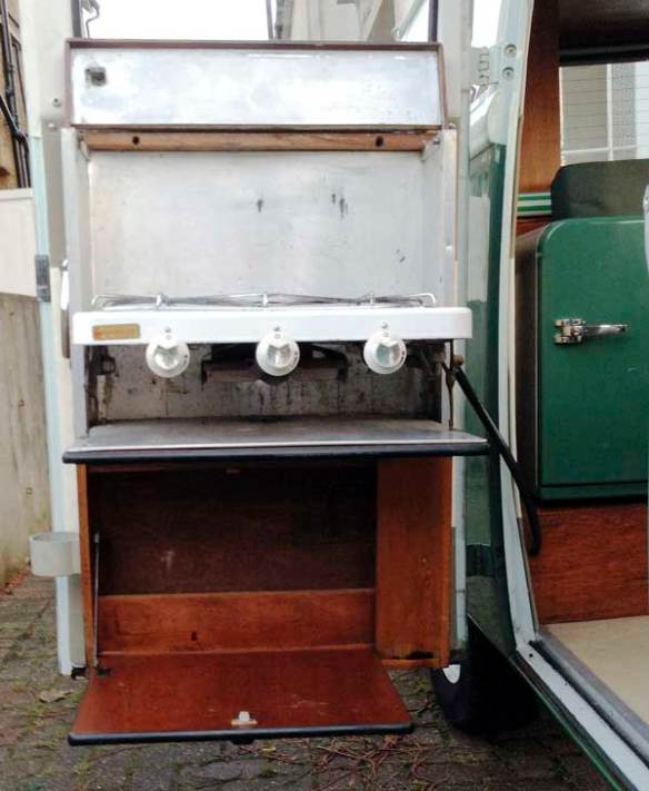The Canterbury Pitt door mounted cooker folds out for use with 2 rings and a grill