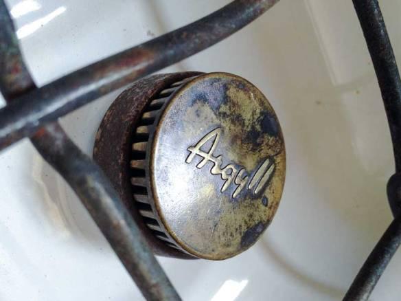 beautiful aged patina on the Canterbury Pitt Argyll gas burner caps