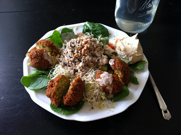 Falafel with spinach, sprouts, quinoa, carrots, cucumbers, sunflower seeds, hummus, tahini.