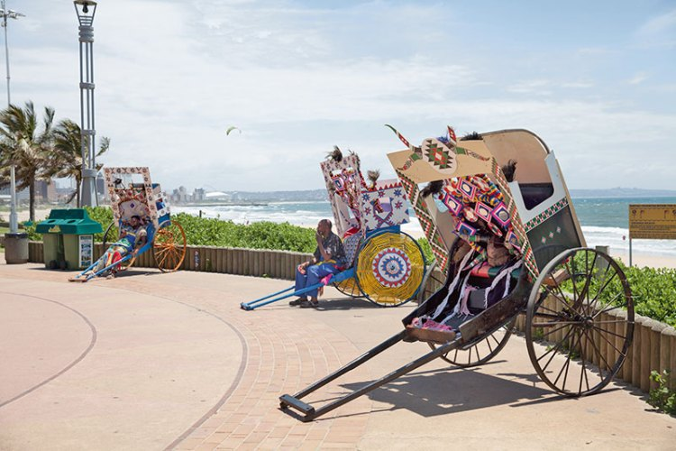 The rickshaw pullers make a colourful sight with their gaily-decorated vehicles