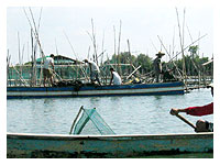 fishermen tending fishpen
