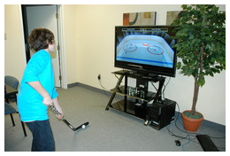 Jacob Burke, age 12, improves his stickhandling skills with his head up, on the new QuickStickz product
