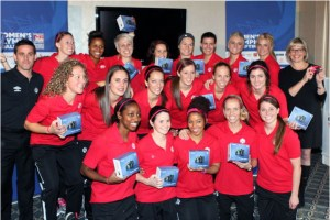 Members of the Canadian Women's National Soccer team show off their new Canon PowerShot cameras, presented to them by Colleen Ryan Senior Director of Corporate Communications, Canon Canada, at right. (Photo: Canon Canada Inc.)