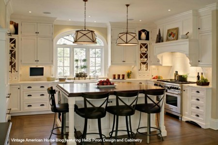 white farm kitchen with bentwood bar stools farm sink pendant lighting hardwood floors and vintage ironstone. design by heidi piron design and cabinetry