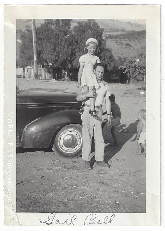 1940s vintage photo of father with kids