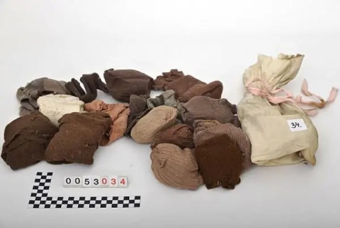 """Pic shows: The objects from the packages. This is the moment an elderly man was temporarily reunited with family property that had been hidden when he was a 13-years-old and his family were evicted in one of largest mass expulsions the world has ever seen. Rudi Schlattner was forced to flee the family casa that had been built by his merchant father after the end of World War II as part of a mass expulsion of Germans from Czechoslovakia after World War II. The destruction of World War II had caused enormous hatred in Czechoslovakia of its ethnic German population, and the government under Czechoslovak President Edvard Benes ordered the """"final solution of the German question"""" by evicting all ethnic Germans from the country. Thousands died during the forced expulsions of 1.6 million ethnic Germans their homes and into the American zone West Germany. These were the fortunate ones, and a further 800,000 were sent to the Soviet zone. Rudi and his family were among those that ended up in the American zone, and before they left they had time to hide their property in the attic of the family home. He said """"We thought we would one day return, and that would find a property there."""" Now in his 80s, he realised that this would now never happen and has now returned to make sure that even if he is not allowed to have the family property back, at least it will not be forgotten and wanted to make sure people understood who it 11 belonged to and why it was there. He contacted municipal officials in the village of Libouch in north-western Czech Republic who used the family casa now as a kindergarten, and where it was a revelation that the items had been hidden in the roof of the refurbishments carried out including the roof. But Rudi's father had done such a good job of hiding it, that nobody had discovered them. He said: """"My father built the villa in 1928 and 1929. He always thought that one day we would return and get it back."""" He was accompanied on the visit to the building by empl"""