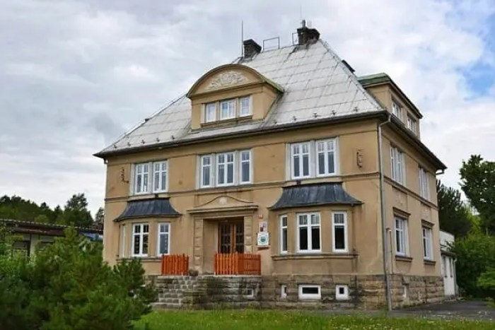 """Pic shows: The house owned by family Schlattner, current kindergarten in Libouch. This is the moment an elderly man was temporarily reunited with family property that had been hidden when he was a 13-years-old and his family were evicted in one of largest mass expulsions the world has ever seen. Rudi Schlattner was forced to flee the family casa that had been built by his merchant father after the end of World War II as part of a mass expulsion of Germans from Czechoslovakia after World War II. The destruction of World War II had caused enormous hatred in Czechoslovakia of its ethnic German population, and the government under Czechoslovak President Edvard Benes ordered the """"final solution of the German question"""" by evicting all ethnic Germans from the country. Thousands died during the forced expulsions of 1.6 million ethnic Germans their homes and into the American zone West Germany. These were the fortunate ones, and a further 800,000 were sent to the Soviet zone. Rudi and his family were among those that ended up in the American zone, and before they left they had time to hide their property in the attic of the family home. He said """"We thought we would one day return, and that would find a property there."""" Now in his 80s, he realised that this would now never happen and has now returned to make sure that even if he is not allowed to have the family property back, at least it will not be forgotten and wanted to make sure people understood who it 11 belonged to and why it was there. He contacted municipal officials in the village of Libouch in north-western Czech Republic who used the family casa now as a kindergarten, and where it was a revelation that the items had been hidden in the roof of the refurbishments carried out including the roof. But Rudi's father had done such a good job of hiding it, that nobody had discovered them. He said: """"My father built the villa in 1928 and 1929. He always thought that one day we would return and get it back."""" He was accompan"""