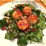 Pan Seared Scallops Over Warm Spinach Pomegranate Salad