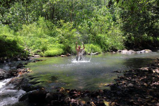 Marc splashing around in the river