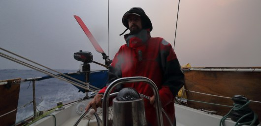 Alex is less than happy dealing with a strong squall during the early part of our passage to Hao