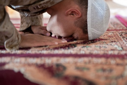 110820-N-TH989-166: Lt. Asif I. Balbale, the chaplain for Assault Amphibian School Battalion at Marine Corps Base Camp Pendelton, Calif., prays by himself at the Afghan Cultural Center aboard Camp Leatherneck, Helmand province, Aug. 17. During the Islamic holy month of Ramadan, Balbale ministered to Muslims throughout the provinces of Helmand and Kandahar.